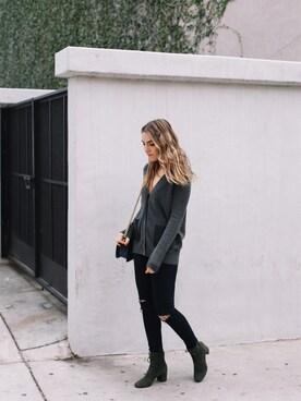 Erin Grey is wearing BARNEYS NEWYORK