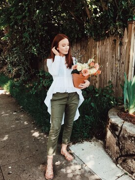 "Maddie Greer is wearing CO ""Co button-up high-low shirt"""