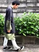 t. kan is wearing VANS