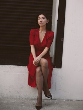 "Stephanie Liu  is wearing The Reformation ""Reformation - Georgette Wrap Mini Dress - Antique rose"""