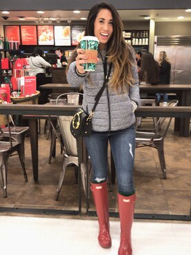 "shell is wearing HUNTER ""Hunter Adjustable Back Gloss Rain Boot"""