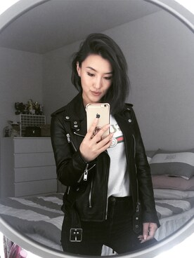 "Gigi Lam is wearing Saint Laurent ""Saint Laurent Slim-Fit Leather Motorcycle Jacket"""