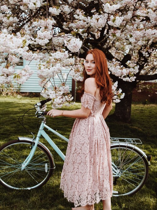 "Maddie Greer is wearing asos ""ASOS Off the Shoulder Lace Prom Midi Dress"""