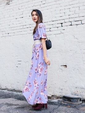 "Amy is wearing Astr ""ASTR Selma Floral Wrap Maxi Dress"""