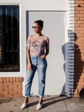 "Grasie Mercedes is wearing Levi's ""Levi's 517 Ultra High-Rise Cropped Bootcut Jeans"""