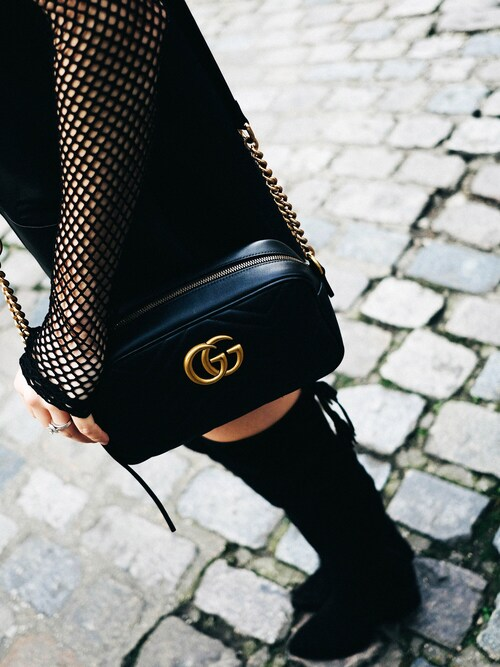 "Bethany Marie is wearing GUCCI ""Gucci GG Marmont 2.0 Medium Quilted Camera Bag, Black"""