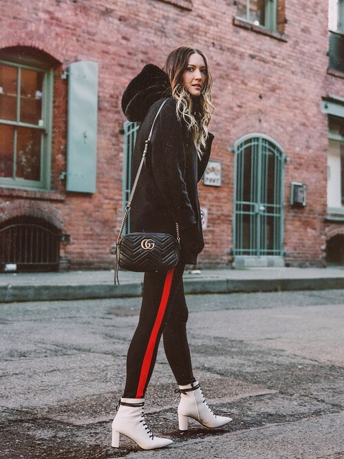 "Bethany Marie is wearing GUCCI ""GG Marmont matelassé shoulder bag"""