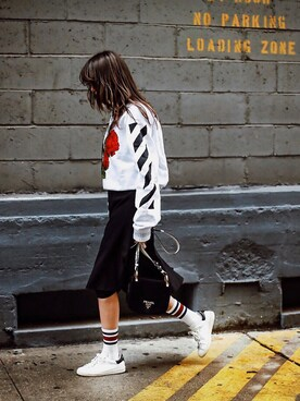 "Thania Peck is wearing Prada ""Prada - Wallet On A Chain Velvet Shoulder Bag - Black"""