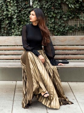 "Ayesha Sid is wearing Chico's ""Metallic Pleat Skirt"""